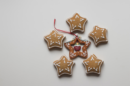 top view of star-shaped Homemade Christmas Cookies and decorative star for xmas tree decoration