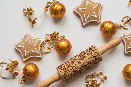 Top view of  Wood Engraved Embossing Rolling Pin with Christmas Symbols for Homemade Christmas Cookies, Baking Christmas cookies , gold balls