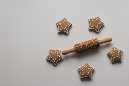 Top view of  Wood Engraved Embossing Rolling Pin with Christmas Symbols for Homemade Christmas Cookies, Baking Christmas cookies Stock Photo