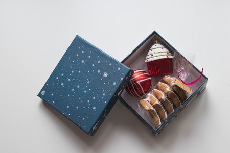 Blue Box with Baking Christmas cookies and cupcake. Top view Stock Photo