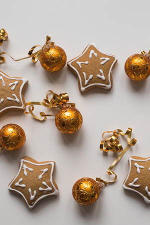 Top view of Baking Homemade Christmas Cookies and golden balls for decoration Stock Photo