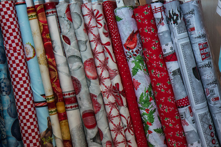 Traditional fabric store with stacks of colorful textiles, fabric rolls at market stall - textile industry background with blurred. Fabric Store, Traditional