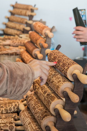 Women choosing and buying wooden  Rolling Pins with Christmas Symbols for Homemade Christmas Cookies Stock Photo