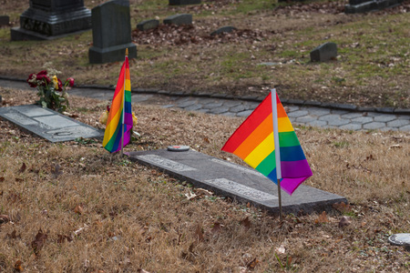 View of graves of LGBT couple with rainbow flags
