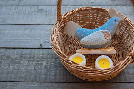 Easter decor with chicken and eggs in basket. spring holiday Easter cute scene. cute chicken toys, Easter eggs on wooden background, Holidays composition. copy space, selected focus