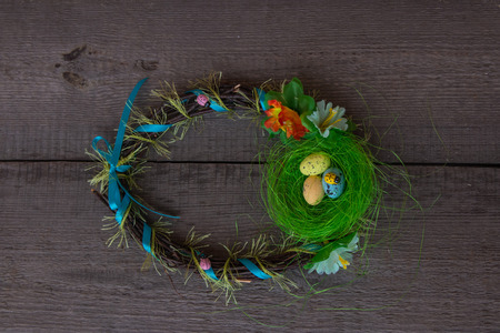 Colorful Easter nest  and Eggs Wreath On wooden  Background Stock Photo