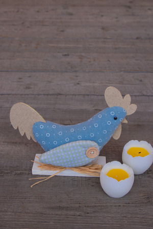 Easter decor with chicken. spring holiday Easter cute scene. cute chicken toys, Easter eggs on wooden background, Holidays composition. copy space, soft selective focus
