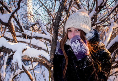 concealed: Beautiful girl covered with a mitten, Arkhangelsk, North