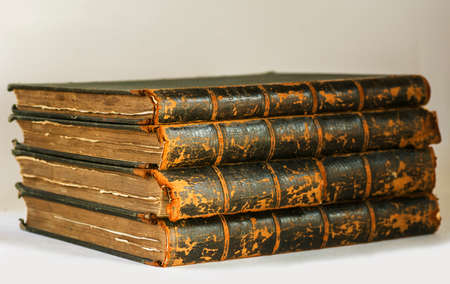 frayed: Antique books with frayed pages pile on white background Stock Photo