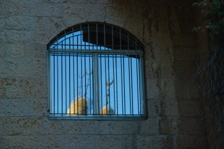 crescent moon: reflection of crescent moon in window of Jewish house in old city Jerusalem