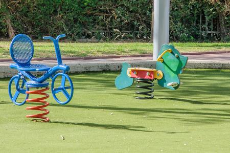 Spring seesaws in the Children playground photo