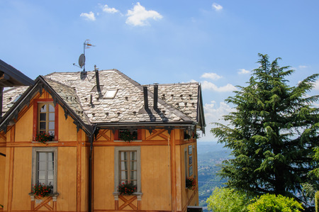 Wooden house against the Como lake landscape, Italy photo