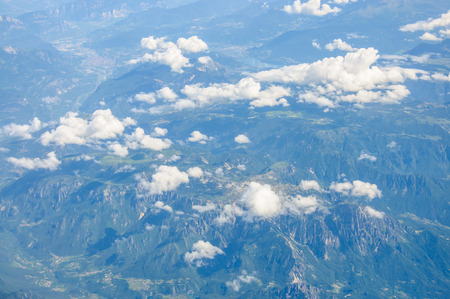 Mountains view from a flying airplane photo