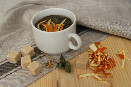zest: tea with lumps of sugar and zest in the fabric