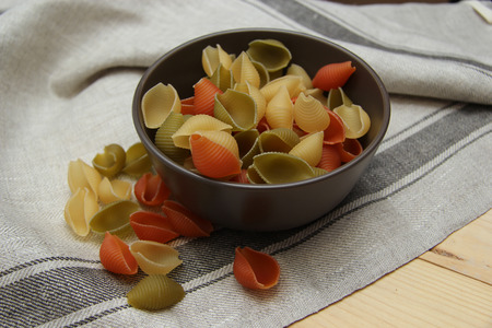 not ready: colored pasta in a brown plate on a tissue