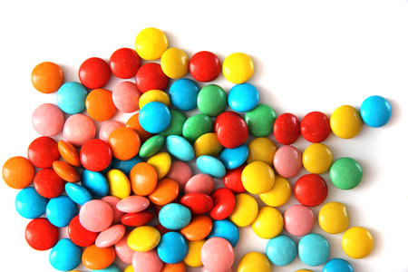 ms: bright colorful round candy M & Ms and chocolate eggs on white background Stock Photo