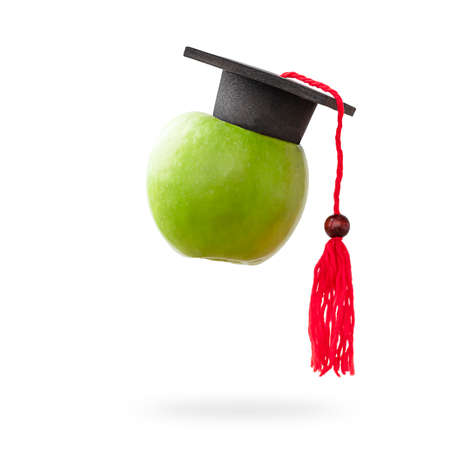 apple with graduate cap on isolated white background