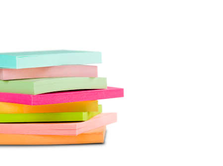 block of sticky notes on isolated white background