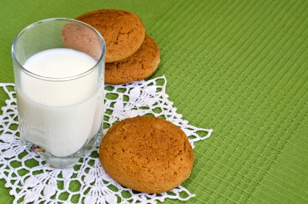 Glass of milk and oat cookies on a knitted napkin  photo