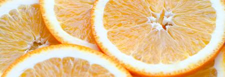 overlapped: Orange yellow overlapped slices close-up background. Stock Photo