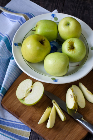 green apples: Group of green fresh apples. Apples cut into slices. Stock Photo
