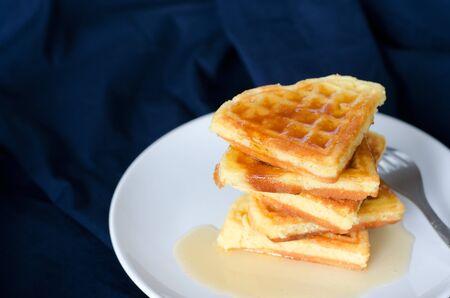 Fresh homemade heart shape waffles on white plate