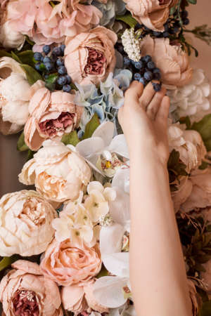 Gentle background for websites and advertising. It consists of peonies, grapes and other flowers. Stock Photo