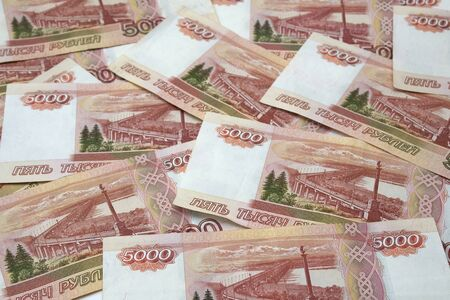 Horizontal background of bundle of five thousand Russian ruble banknotes. Concept of wealth, earnings, independence, investment. Russian money
