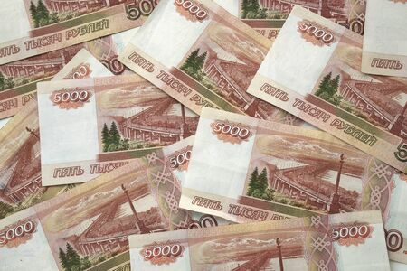 Horizontal background of bundle of five thousand Russian ruble banknotes. Concept of wealth, earnings, independence, investment. Russian money Stock Photo - 128737080