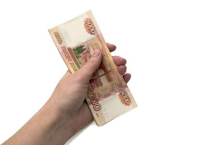 Isolated bundle of five thousand Russian ruble banknotes in the hand of a woman on a white background. Concept of wealth, earnings, independence, investment. Russian money Stock Photo