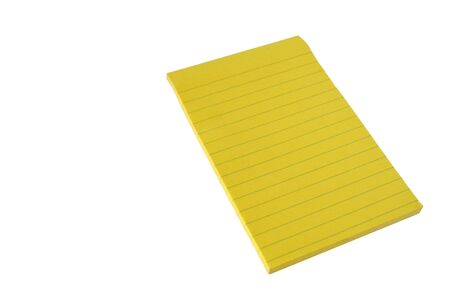 Isolated lined block of yellow paper on a white background. Notepad for notes