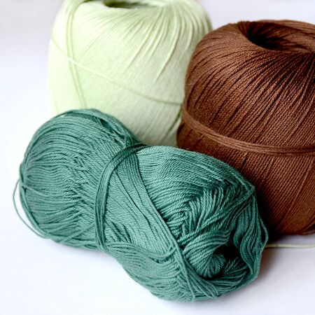 Three skeins for knitting brown, dark green and light green