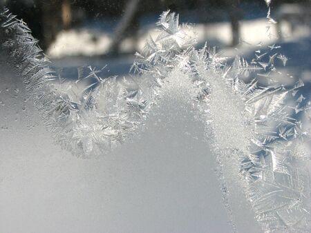 Frosty winter patterns on the glass. Horizontal background 스톡 콘텐츠