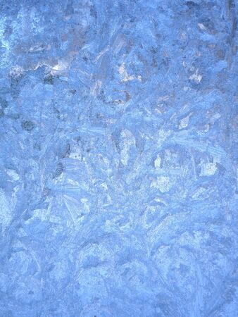 Frosty winter patterns on the glass. Vertical background 스톡 콘텐츠