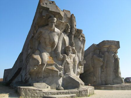 Adzhimushkay quarries in Kerch, Crimea, Russia. Monument to the dead soldiers of Adzhimushkay on the background of summer blue sky Standard-Bild