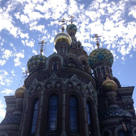 Church of the Savior on Blood in Saint Petersburg on the background of bright blue sky with clouds. Bottom view