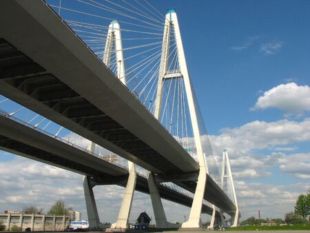 Bottom view of the Big Obukhovsky Bridge in sunny summer day in St. Petersburg, Russia. Cable bridge Imagens
