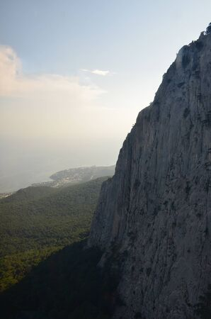 View from Mount Ai-Petri in Crimea, Russia. View of the sea in the haze, blue sky, mountain and coast