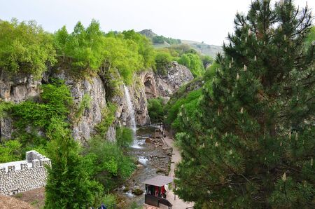 Panorama of Honey Waterfalls on a sunny day in Karachay-Cherkessia, Caucasus, Russia. View from above