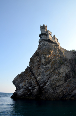 Castle Swallow Nest, Yalta, Crimea, Russia. Monument of architecture on a cliff with a rift over the Black Sea. Vertical photo Editorial