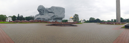 Brest, Belarus - June 13, 2014: Banner with the image of the monument Courage in the Brest Fortress, Belarus. Panorama of the Brest Fortress on a gloomy summer day on a background of gray sky