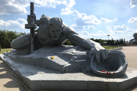 The sculptural composition Thirst in the Brest Fortress, Belarus. Monument on a background of summer blue sky with clouds in the rays of the sun Editorial