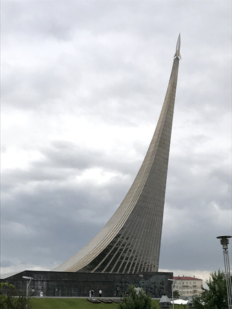 Monument To the Conquerors of Space, Space Museum in Moscow, Russia. A giant monument in the form of an upward rocket against a gray cloudy sky