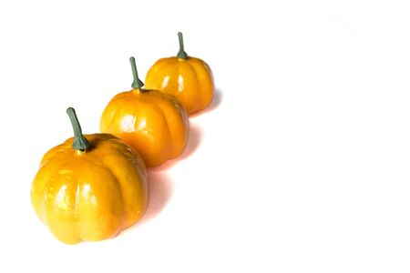 Isolated autumn background of fruits and vegetables: pumpkins on a white background with copy space. Halloween and harvest concept. Banco de Imagens