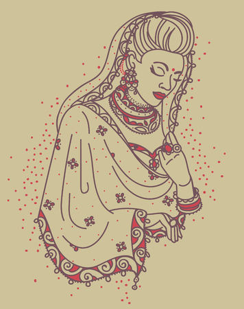 Portrait of a beautiful praying Indian woman in traditional saree.
