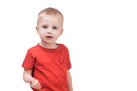 looking into camera: cute child boy looking into camera on white, isolated
