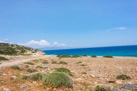 Natural landscape of hills, sand, grass, sea, clouds and blue sky on the Crete Island Greece