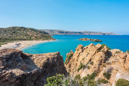 Natural landscape of mountains, hills, sand, grass, sea, clouds and blue sky on the Crete Island Greece, Vai beach