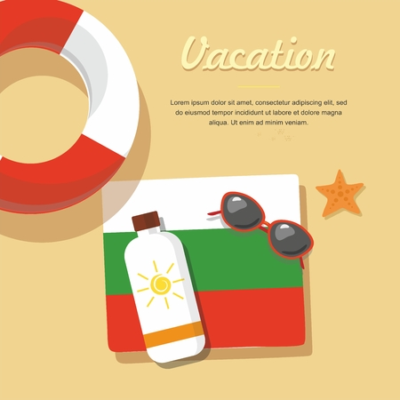 Bulgaria Tourism. lifebuoy in the sand with towel, sun glasses and others