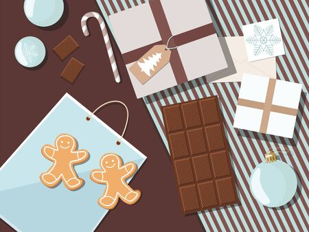 Christmas and New year composition with gifts, cookies, greeting card and christmas balls. Top view.
